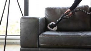 vacuum black leather couch